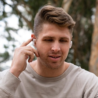 Guy wearing JBuds Air Executive True Wireless Earbuds