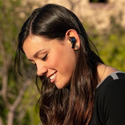 Girl wearing JBuds Air Executive True Wireless Earbuds