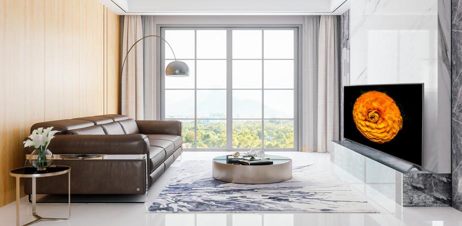 Televizorul UHD de la LG, montat pe un perete în camera de zi, cu un interior minimalist. Imaginea unei flori este prezentată pe un ecran TV.